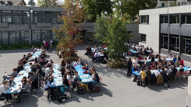 Students outside the Campus restaurant of the University of St.Gallen (HSG)